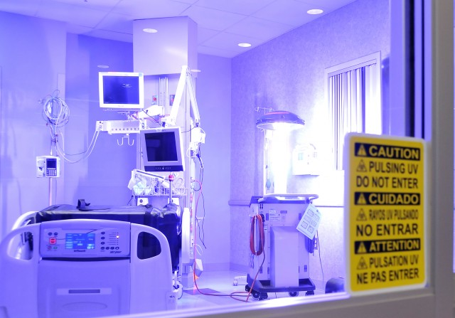 L-VIRA, a germ-zapping robot, emits a flash of ultraviolet c (UVC) light for disinfection of an Intensive Care Unit hospital room at William Beaumont Army Medical Center (Photo Credit: U.S. Army).