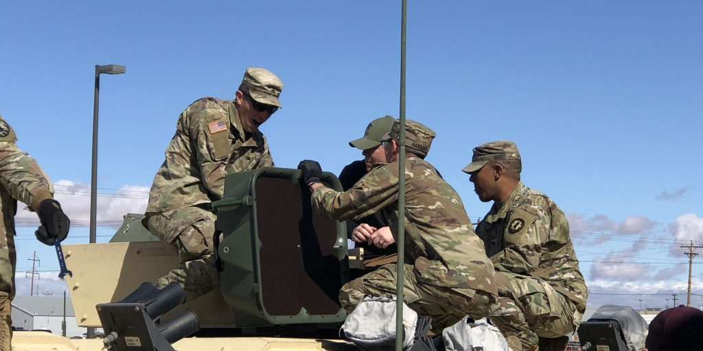 An acoustic hailing device (AHD) being installed on a High Mobility Multipurpose Wheeled Vehicle (HMMWV) (Source: U.S. Army Picatinny Arsenal).